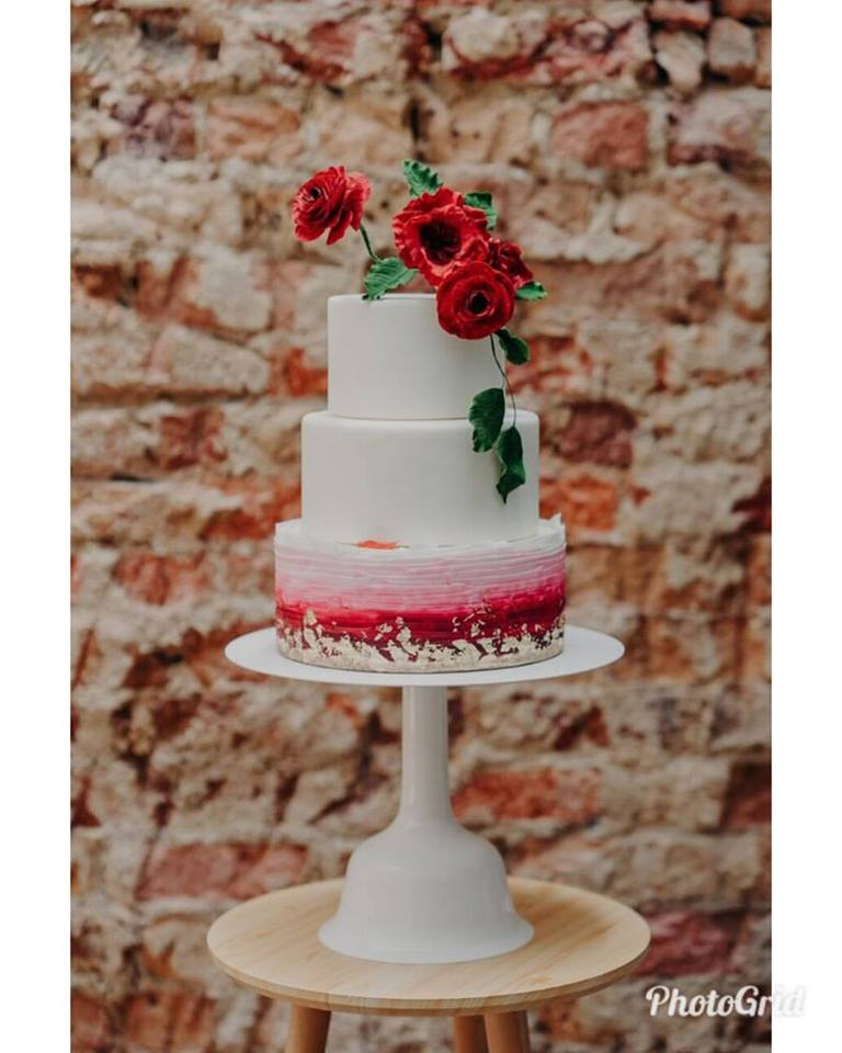 ombre red 3 tier cake with ranunculus, garden roses